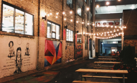 String lighting, murals and picnic tables in Goudies Lane