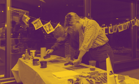 two people participating in a screen-printing class